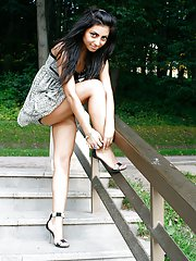 Some of her shoots here feature girl getting barefoot in a park and just soaking in the warmth and softness of the summer grass. With her shoes standi